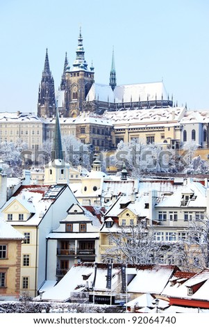 Romantic Snowy Prague gothic Castle above the River Vltava in the sunny Day - stock photo