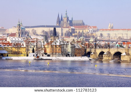 Romantic Snowy Prague gothic Castle with the Charles Bridge in the sunny Day,  Czech Republic - stock photo