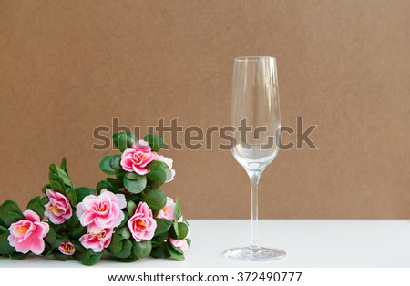 Romantic still life with  glass champagne and beautiful pink flower. Soft focus - stock photo