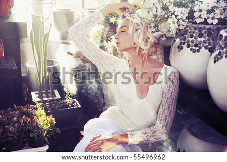 Romantic style photo of a gorgeous blond beauty - stock photo