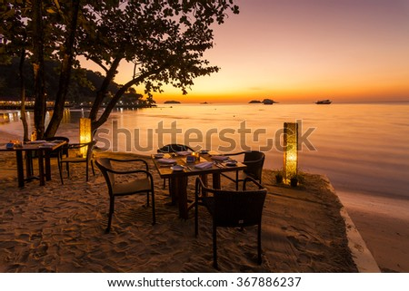 Romantic sunset on the shore of a tropical island. Cafe on the beach. Koh Chang. Thailand. - stock photo