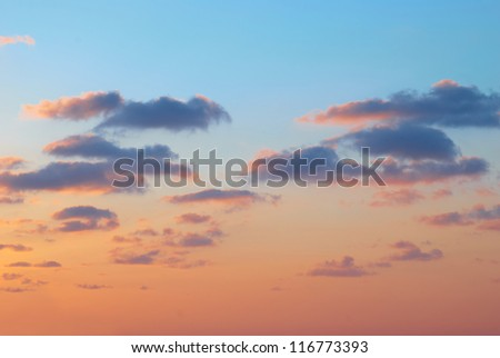 Romantic sunset with beautiful blue, red and yellow clouds. - stock photo
