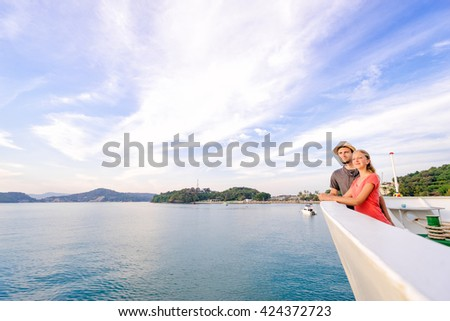 Romantic vacation. Young loving couple enjoying view on cruise ship deck. Sailing the sea. - stock photo