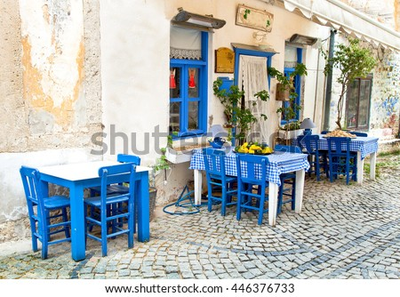 Romantic vintage scene, table and chair, Alacati - stock photo