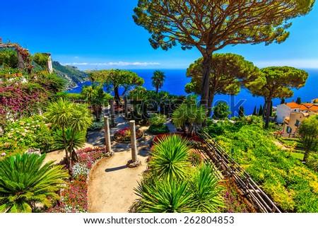 Romantic walkway and ornamental garden with colorful flowers,Villa Rufolo,Ravello,Amalfi coast,Italy,Europe - stock photo
