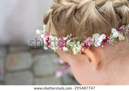 romantic wedding: flower child with floral wreath - stock photo