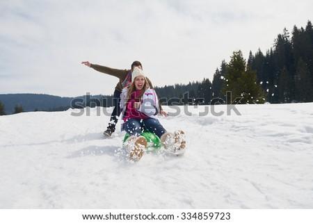 romantic winter  scene, happy young couple having fun on fresh show on winter vacatio, mountain nature landscape - stock photo