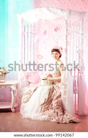 Romantic woman in a pink vintage dress - stock photo