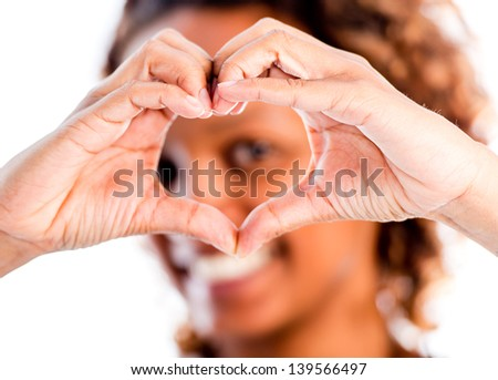 Romantic woman making a heart - isolated over a white background - stock photo