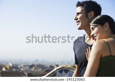 Romantic young couple enjoying view at Barcelona - stock photo