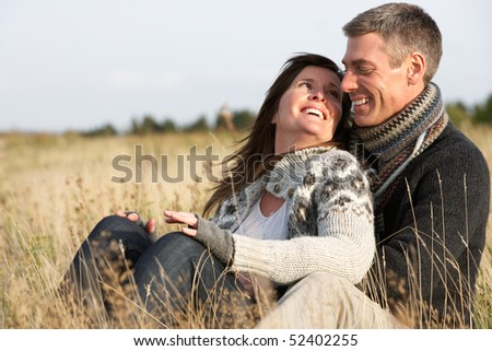Romantic Young Couple In Autumn Landscape - stock photo