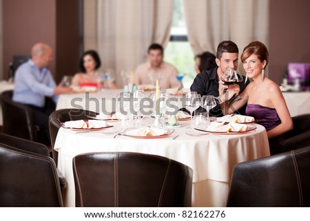 romantic young couple in restaurant date toast - stock photo