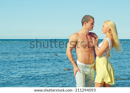 Romantic young couple near the sea. - stock photo