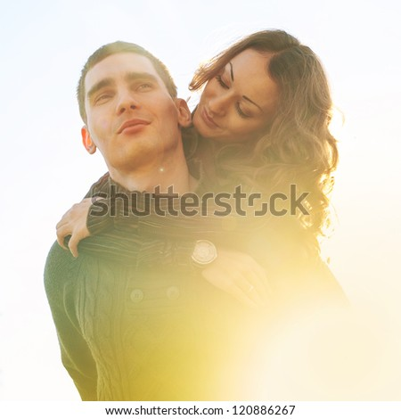 Romantic young couple outdoors with back light. - stock photo