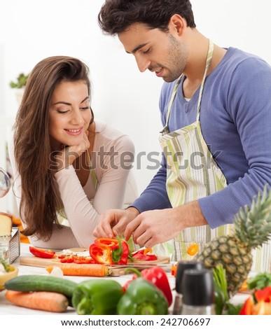 Romantic young couple preparing dinner. - stock photo