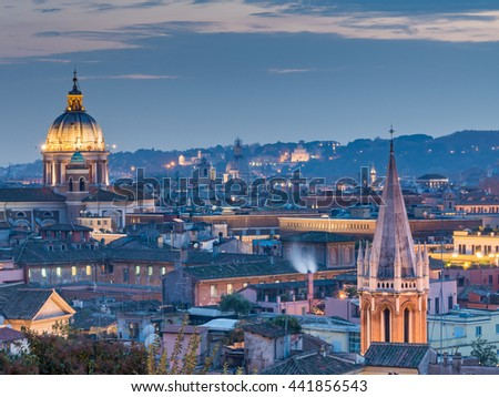 Rome Aerial View of skyline cityscape rooftop panorama, San Carlo al Corso Church at night, Vittorio Emanuele, Piazza Venezia with St Peter Cathedral (Prominent Basilica San Pietro in Vatican), Italy - stock photo