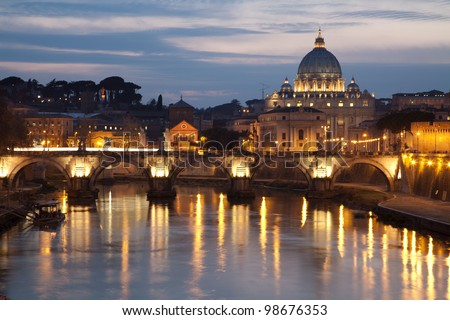 Rome - Angels bridge and St. Peter s basilica in evening - stock photo