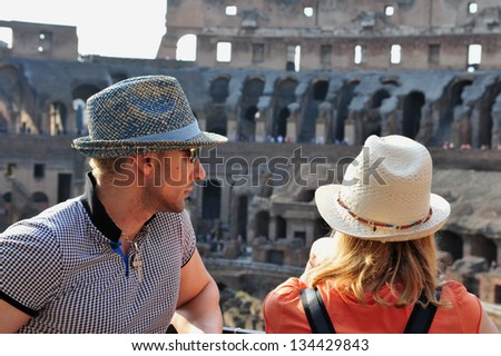 ROME - APRIL 29:A couple visit at the Colosseum on April 29 2011 in Rome Italy.The original name of the Coliseum was Flavian Amphitheater, after the Flavian Dynasty of Roman Emperors. - stock photo