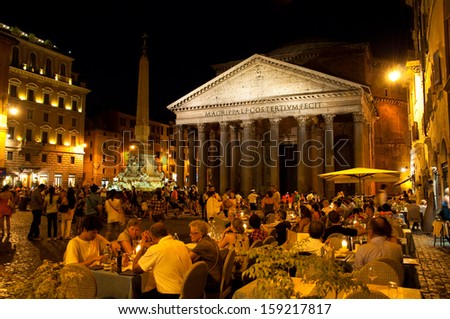 ROME-AUGUST 7: The Pantheon at night on August 7, 2013 in Rome, Italy. The Pantheon is a building in Rome, Italy to all the gods of ancient Rome rebuilt by the emperor Hadrian about 126 AD. - stock photo