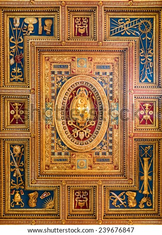 Rome, Basilica San Giovanni in Laterano (St. John Lateran). Carved ceiling made by Flaminio Boulanger in XVI century, with Papal coat of Arms, inside this cathedral in Rome, Italy. - stock photo