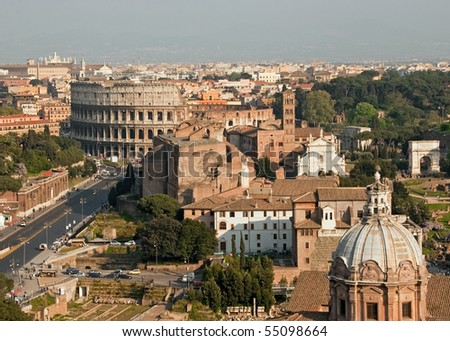 Rome cityscape seen with Coliseum, Roman Forum and San Pietro in carcere Church. - stock photo