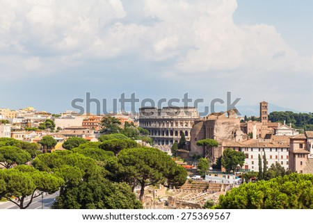 Rome cityscape with view of ruins and colosseum near Altare della Patria - stock photo