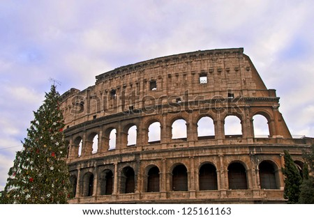 ROME - DECEMBER 18: Colosseum facade on December 18, 2011 in Rome. The Colosseum is an elliptical amphitheatre in the centre of Rome and is considered one of the greatest works of Roman architecture. - stock photo
