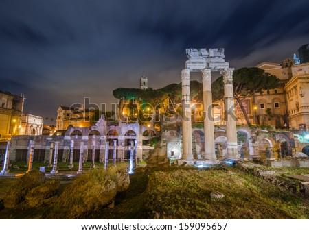 rome forum by night - stock photo