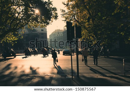 Rome in early morning. Street view. People crossing the street. Retro tinted photo - stock photo