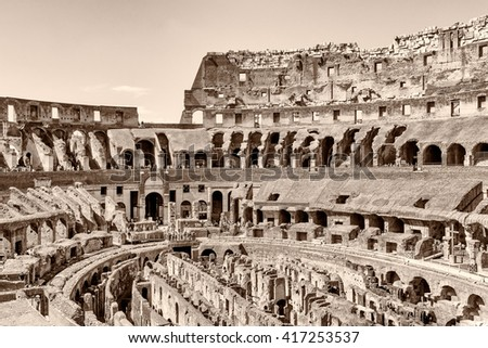ROME, ITALY -April 11, 2016; A monochromatic inside view of the impressive ancient roman Colosseum situated in the Rome, the capital of Italy. - stock photo