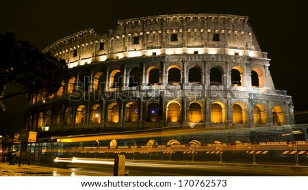 ROME, ITALY - APRIL 24: Ancient Roman Colosseum at night on April 24, 2008 in Rome, Italy. The Colosseum, the largest amphitheatre in the world, is an elliptical amphitheatre in the centre of Rome - stock photo