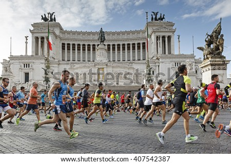Rome, Italy - April 10, 2016: Athletes participating in the Rome Marathon in 2016 while crossing Piazza Venezia, in the background the famous Vittoriano monument. - stock photo