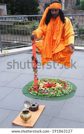 ROME, ITALY - APRIL 28, 2014: Indian Fakir performs levitation trick in Rome. - stock photo