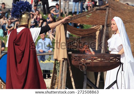 ROME, ITALY - APRIL 21, 2015:  Rome Foundation Anniversary historical reconstruction, priestess and Centurion with sacred fire - stock photo