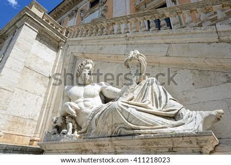 ROME, ITALY- APRIL 19,2016: Statue of god(Tiber) with cornucopia at square Piazza del Campidoglio. - stock photo