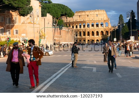 ROME, ITALY-APRIL 21, 2012: The Colosseum, or the Coliseum, one of the greatest works of Roman architecture and Roman engineering, at the end of the street, on April 21, 2012 in Rome. - stock photo