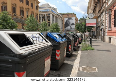 Rome, Italy - August 17, 2015: Garbage containers at row on the street Via Venti Settembre - stock photo