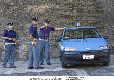 ROME-ITALY, AUGUST 28, Italian police on duty at the walls of the Vatican in Rome August 28, 2013. Servant of the law expresses dissatisfaction with the photo session - stock photo