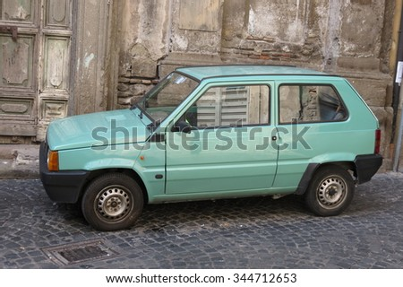ROME, ITALY - CIRCA OCTOBER 2015: light green FIAT Panda car parked in a street of the city centre - stock photo