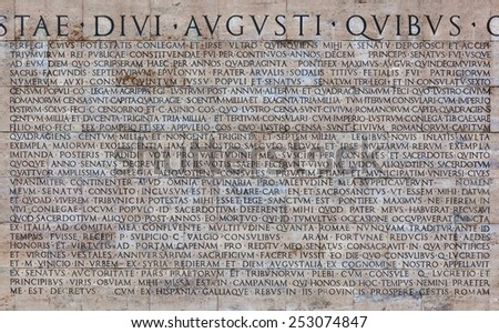 ROME, ITALY - DECEMBER 02, 2014: Copy of the Res Gestae Divi Augusti placed on the back of the Museum of the Ara Pacis in Rome, Italy. - stock photo