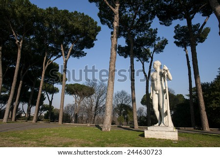 ROME, ITALY - JANUARY 2015, 15: A marble statue. EUR district is known as a striking example of Fascist architecture where Benito Mussolini planned to hold a world fair in 1942. - stock photo