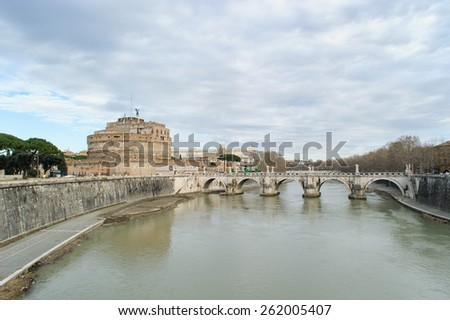 ROME, ITALY - JANUARY 27, 2010: Castel Sant'Angelo(the origin name is Mausoleum of Hadrian) is a towering cylindrical building situated on the bank of  the tiber river in Parco Adriano, Rome,  - stock photo