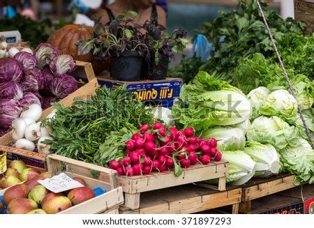 ROME, ITALY - JUNE 15, 2015: Fresh fruits and vegetables for sale in Campo de Fiori, famous outdoor market in central Rome. - stock photo