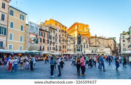 ROME, ITALY, JUNE 1, 2014: people are strolling through famous piazza farnese in italian capital rome. - stock photo