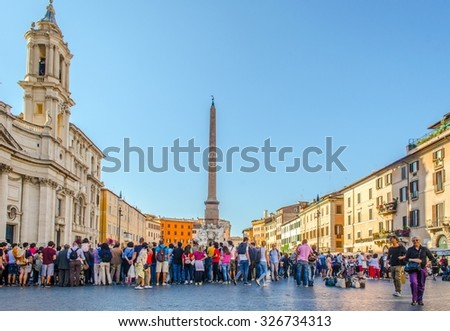 ROME, ITALY, JUNE 1, 2014: People are walking around piazza Navona during early summer. - stock photo