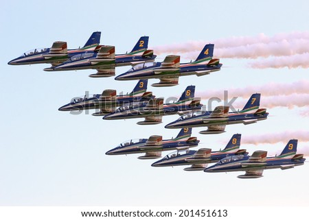 ROME, ITALY - JUNE 28, 2014:  The aerial acrobatics of the Italian Air Force Frecce Tricolori during the event of the Rome International Air Show held in Ostia beach - stock photo
