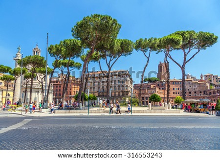 Rome, Italy - JUNE 15, 2013: Tourists visiting the Roman Forum of Trajan attraction. - stock photo