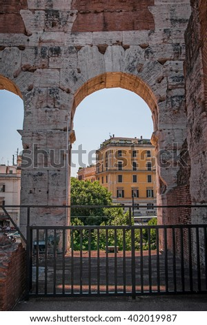 ROME, ITALY - JUNE, 6: View through an arch of the Colosseum on the street on 6 june 2012 - stock photo