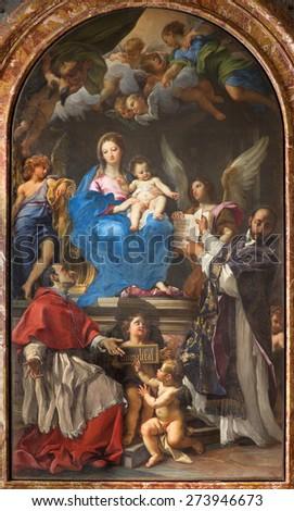 ROME, ITALY - MARCH 26, 2015: Madonna Enthroned with SS Charles Borromeo and Ignatius by Carlo Maratta 1680  in church Chiesa Nuova (Santa Maria in Vallicella). - stock photo