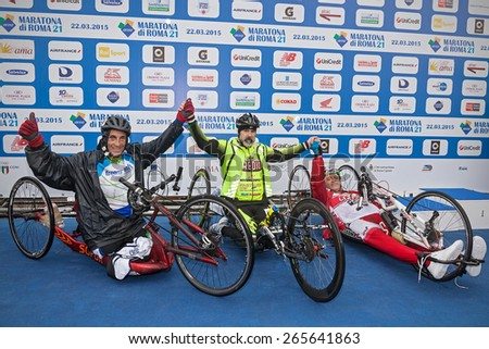 Rome, Italy - March 22, 2015: 21th Rome Marathon. Winner of the race handbike Fabrizio Caselli (center), with (to his right) runner Fabrizio Bove, and (to his left) Gian Luca Laghi. - stock photo